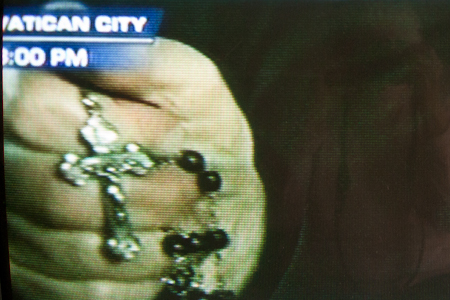 Rosary held by nun