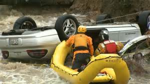 Rescue boat approaches overturned car